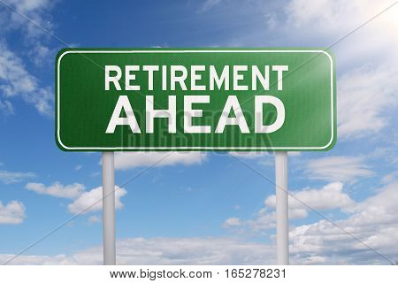 Image of text of retirement ahead on a green road sign under clear sky