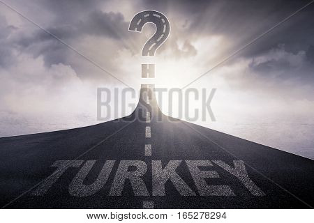 Turkey written on the asphalt way with question mark at the end of a road