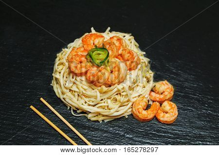Asian Food: Rice Noodles With Shrimp And Vegetables Close-up O