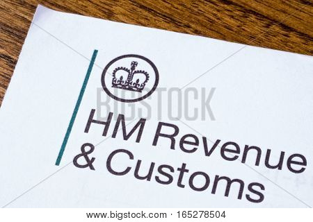 LONDON UK - JANUARY 13TH 2017: The logo of Her Majestys Revneue and Customs on a piece of paper on 13th January 2017. HMRC is a non-ministerial dept of the UK Government.