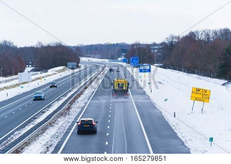 OLDENZAAL NETHERLANDS - JANUARY 15 2017: Specialized truck for sprinkling a hot brine solution under high pressure on highways with multiple lanes to prevent slipperiness
