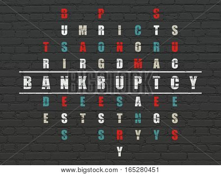 Finance concept: Painted white word Bankruptcy in solving Crossword Puzzle