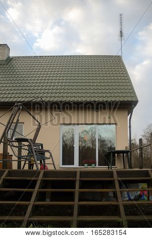 part of house with terrace rocking chair