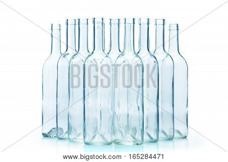 Group of empty glass wine bottles standing isolated on white