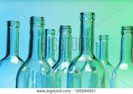 Empty glass bottles with close-up focus to the necks and opened tops
