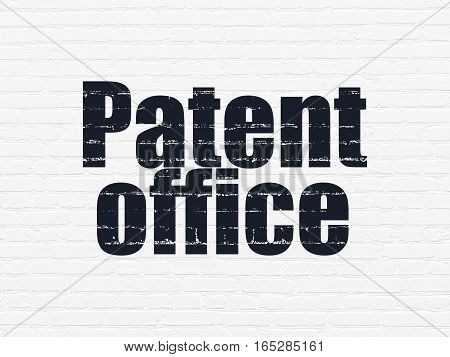 Law concept: Painted black text Patent Office on White Brick wall background