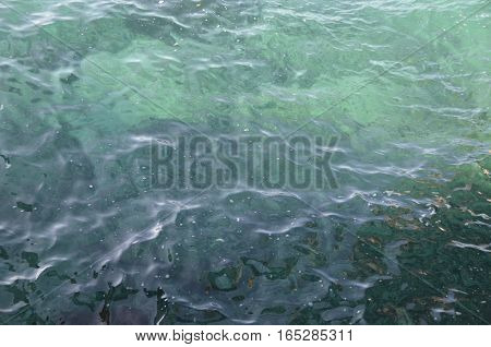 surface of sea water, the glare on the water background with water texture