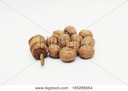 Dry figs and Walnuts isolated on white background