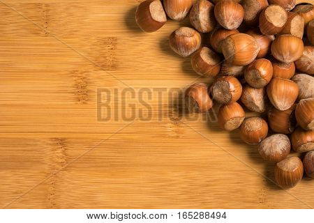 Hazelnuts isolated on wooden table with space to place your logo