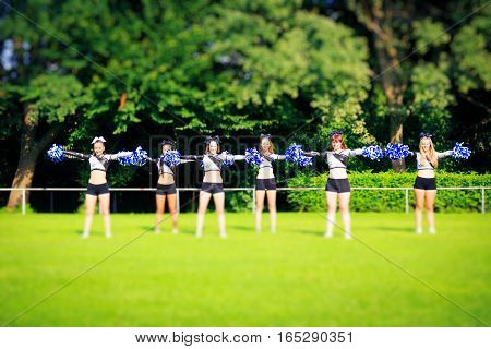 Photo of cheerleaders practicing on playing field