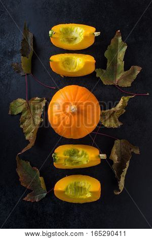 autumn composition with pumpkin and leaves. Top view