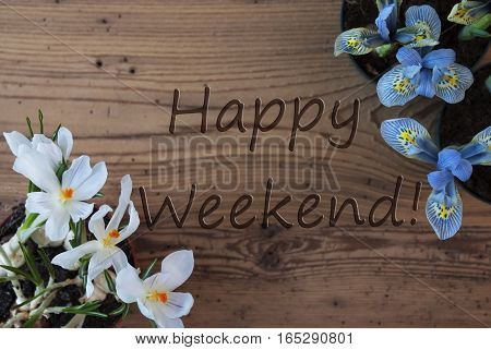 Wooden Background With English Text Happy Weekend. Spring Flowers Like Grape Hyacinth And Crocus. Aged Or Vintage Style