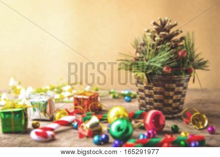 Christmas and new year wooden background banner with gift box daisy flower candy ball and decoration on vintage background.