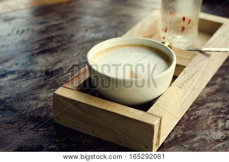 close up coffee cup on wooden table