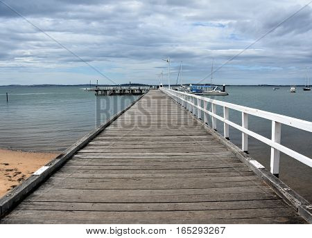 Old wood bridge pier at Rhyll (Philip Island Victoria Australia). Old wooden jetty with natural background.