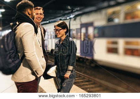 Young adults on their way to work, commuting on subway