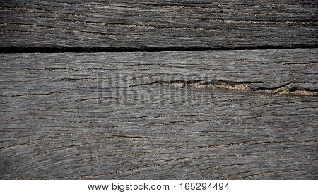 Wood pier abstract texture of a natural gray. View of old weathered deck wooden board. Horizontal wood background texture.