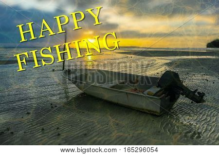 Word Happy Fishing on the background with fishing boat on the beach during sunrise.Fishing concept.
