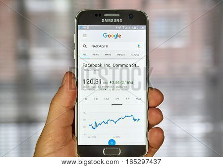 MONTREAL CANADA - DECEMBER 23 2016 : Google Finance page with stock chart and FB ticker on Samsung S7 screen.