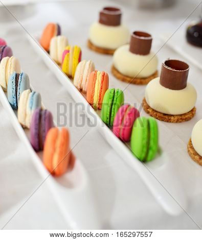 French counter with colorful cakes for sale