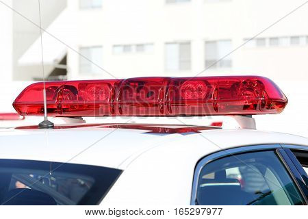 Police red light mounted on the roof of police car