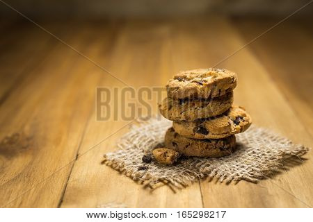 Chocolate cookies on a cloth sack on wood. Chocolate chip cookies shot on a brown cloth.