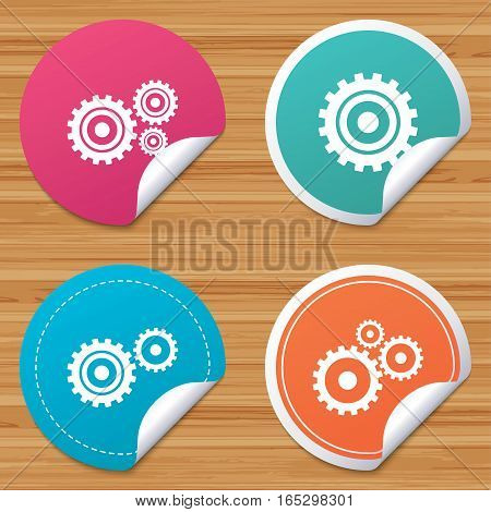 Round stickers or website banners. Cogwheel gear icons. Mechanism symbol. Website or App settings sign. Working process performance. Circle badges with bended corner. Vector