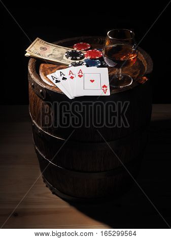 Dollars And Playing Cards On A Wooden Barrel