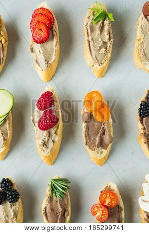Colored bruschetta with pate berries dried fruits. Bruschetta. Berries and fruit. Snack. Copyspace