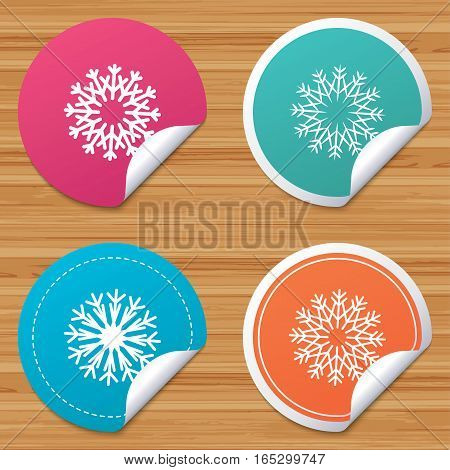 Round stickers or website banners. Snowflakes artistic icons. Air conditioning signs. Christmas and New year winter symbols. Circle badges with bended corner. Vector