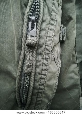 The steel zipper of the old jacket