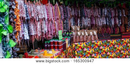 Churchkhela in the street market in Georgia. Churchkhela is a traditional sausage-shaped candy originating from Georgia.