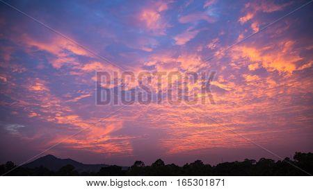 Fiery cloudy sky expose cloudy orange sky in twilight time