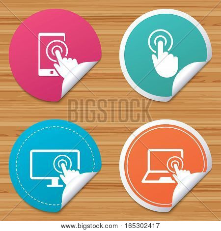 Round stickers or website banners. Touch screen smartphone icons. Hand pointer symbols. Notebook or Laptop pc sign. Circle badges with bended corner. Vector