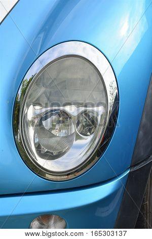 Shiny chrome close up of car headlight