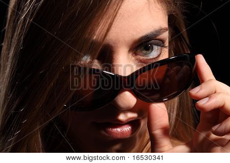 Woman with sexy look in dark sunglasses