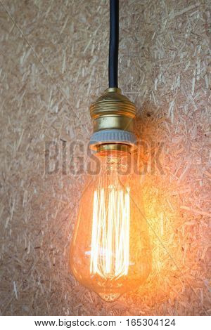 Vintage hanging light bulb decorated on brown wall stock photo