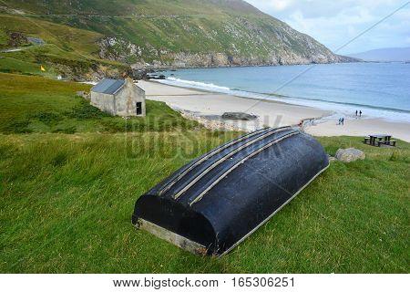 Upturned small boat foregrounding beautiful bay on Ireland's West Coast