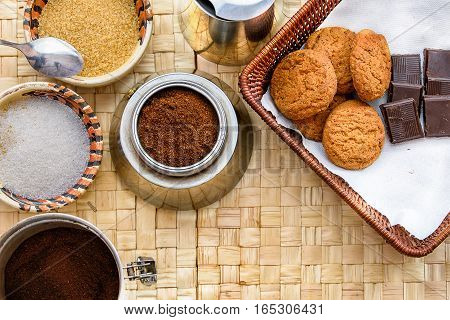 Morning coffe table with sugar chocolate and biskits