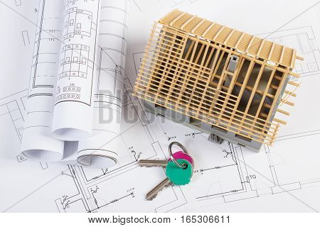 Home Keys, Small House Under Construction And Electrical Drawings, Building Home Concept