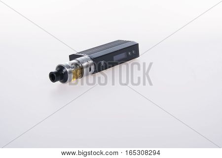 Electronic Cigarette Or Vaping Device On Background.
