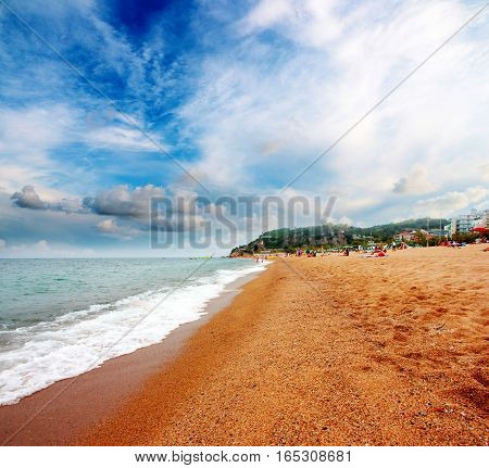 beautiful sunny sandy beach on the Mediterranean Sea and the heavenly light landscape with clouds