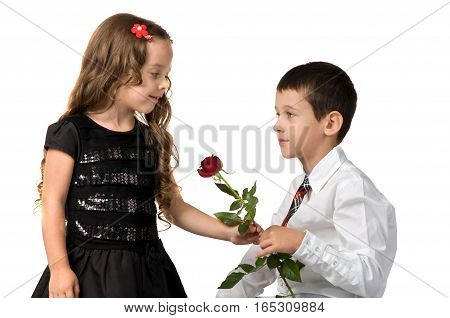 relationship between young children. boy gives a girl flowers. as adults