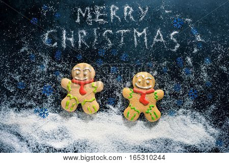 Baking Gingerbread Men For Christmas On Dark Table