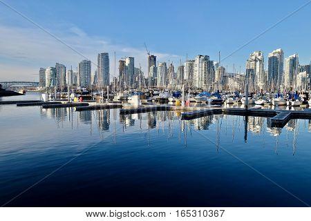 City harbor and boats in marina. Heather Civic Marina. Granville Bridge. Downtown Vancover. British Columbia. Canada.