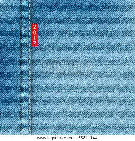 Light blue jeans texture. Denim background with red label and text 2017