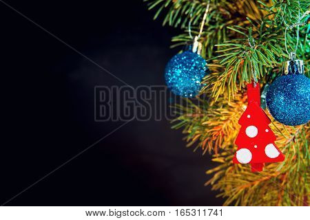 Christmas Baubles On A Fir Tree Branch With Garland