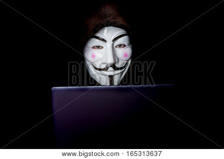 Portrait Of Man With Laptop And Vendetta Mask Isolated On Black