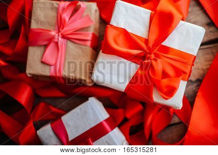Valentine's Day Concept. Gift With Red Bow  On The Wooden Backgr