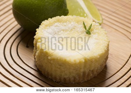 lime tart and sweet with lemon on wooden background